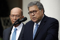 Attorney General William Barr speaks about the census as Commerce Secretary Wilbur Ross listens during an event with President Donald Trump in the Rose Garden at the White House, on July 11, 2019, in Washington. (AP Photo/Alex Brandon)