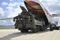Military vehicles and equipment, parts of the S-400 air defense systems, are unloaded from a Russian transport aircraft, at Murted military airport in Ankara, Turkey, on July 12, 2019. (Turkish Defence Ministry via AP, Pool)