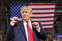 U.S. President Donald Trump arrives to speak at a campaign rally at Williams Arena in Greenville, North Carolina, on July 17, 2019. (AP Photo/Carolyn Kaster)