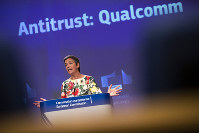 European Antitrust Commissioner Margrethe Vestager talks to journalists during a news conference at the European Commission headquarters in Brussels, on July 18, 2019. The European Union has fined U.S. chipmaker Qualcomm $271 million, accusing it of