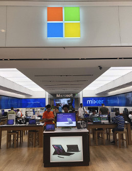 In this July 11, 2019 photo, a Microsoft store is shown in Aventura, Fla. (AP Photo/Wilfredo Lee)