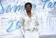 This June 25, 2019 file photo shows British singer-songwriter-producer Labrinth at the Serpentine Gallery Summer Party in London. (Photo by Joel C Ryan/Invision/AP)