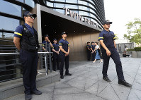 South Korean police officers stand guard against possible rallies against Japan in front of a building where the Japanese Embassy is located in Seoul, South Korea, July 19, 2019. (AP Photo/Ahn Young-joon)