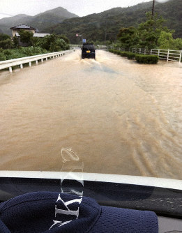 A road that was flooded after heavy rain is seen in Goto, Nagasaki Prefecture, on July 20, 2019. (Photo provided by a resident)