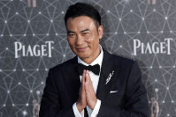 In this April 3, 2016 file photo, Hong Kong actor Simon Yam poses on the red carpet of the Hong Kong Film Awards in Hong Kong. (AP Photo/Vincent Yu)