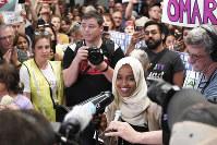 U.S. Rep. Ilhan Omar speaks to supporters as she arrives at Minneapolis-Saint Paul International Airport on July 18, 2019, in Minnesota. (Glen Stubbe/Star Tribune via AP)