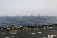 In this July 4, 2019 photo made available by U.S. Navy, two F/A-18 Super Hornets assigned to Carrier Air Wing (CVW 7) drop 1000-pound general-purpose bombs during an Independence Day air power demonstration next to the Nimitz-class aircraft carrier USS Abraham Lincoln in Arabian Sea. (Mass Communication Specialist 3rd Class Dan Snow/U.S. Navy via AP)