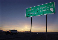 In this April 10, 2002 file photo, a vehicle moves along the Extraterrestrial Highway near Rachel, Nevada, the closest town to Area 51. (AP Photo/Laura Rauch)