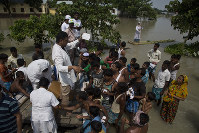 Medical officers distribute medicines to flood victims in Gagalmari, northeastern Indian state of Assam, on July 19, 2019. (AP Photo/Anupam Nath)