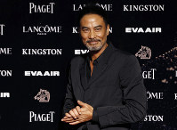 In this Nov. 21, 2015, file photo, Hong Kong actor Simon Yam poses on the red carpet at the 52nd Golden Horse Awards in Taipei, Taiwan. (AP Photo/Wally Santana)