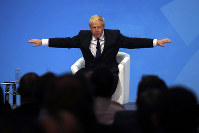 Conservative party leadership candidate Boris Johnson gestures while taking questions during a Conservative leadership hustings at ExCel Centre in London, on July 17, 2019. (AP Photo/Frank Augstein)