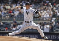 New York Yankees' Masahiro Tanaka, of Japan, delivers a pitch during the first inning of a baseball game against the Colorado Rockies, July 20, 2019, in New York. (AP Photo/Frank Franklin II)