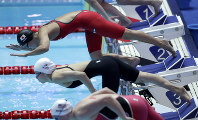 Japan's Rika Omoto, top, starts in her heat of the women's 200m individual medley at the World Swimming Championships in Gwangju, South Korea, on July 21, 2019. (AP Photo/Mark Schiefelbein)