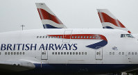 This Jan. 10, 2017 file photo shows British Airways planes parked at Heathrow Airport in London. (AP Photo/Frank Augstein)
