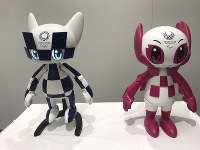 In this July 18, 2019, photo, robots of Olympic and Paralympic mascots