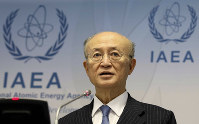 In this Nov. 22, 2018, file photo, International Atomic Energy Agency (IAEA) Director General Yukiya Amano of Japan addresses the media during a news conference after a meeting of the IAEA board of governors at the International Center in Vienna, Austria. (AP Photo/Ronald Zak)