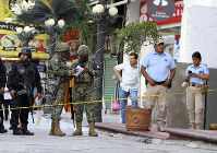 Soldiers from the National Guard, State Police officers of Guerrero and Municipal Police officers of Acapulco guard an area where gunmen killed and wounded multiple people inside a bar in Acapulco, Mexico, on July 21, 2019. (AP Photo/Bernardino Hernandez)