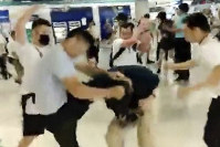 In this image taken from a video footage run by The Stand News via AP Video, white shirted men attacked a man dressed in black shirt at a subway station in Hong Kong on July 21, 2019. (The Stand News via AP Video)