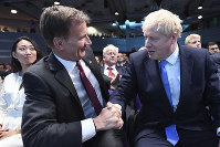 Jeremy Hunt, left, congratulates Boris Johnson after the announcement of the result in the ballot for the new Conservative party leader, in London, on July 23, 2019. (Stefan Rousseau/Pool photo via AP)