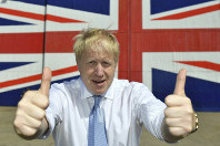 In this June 27, 2019 file photo, Conservative leadership candidate Boris Johnson gives the thumbs-up at the Wight Shipyard Company during a visit to the Isle of Wight, Britain. (Dominic Lipinski/Pool Photo via AP)