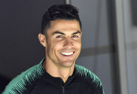 In this June 8, 2019, file photo, Portugal's Cristiano Ronaldo smiles when he arrives to a training session at the Bessa stadium in Porto, Portugal. (AP Photo/Martin Meissner)