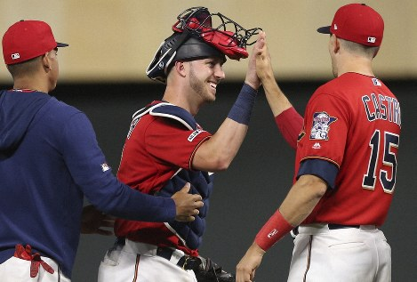 Minnesota Twins' catcher Mitch Garver, center, is congratulated by fellow catcher Jason Castro, right, after they defeated the New York Yankees in a baseball game on July 22, 2019, in Minneapolis. (AP Photo/Jim Mone)