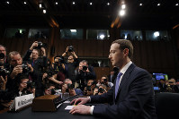 In this April 10, 2018, file photo Facebook CEO Mark Zuckerberg takes his seat to testify before a joint hearing of the Commerce and Judiciary Committees on Capitol Hill in Washington. (AP Photo/Alex Brandon)