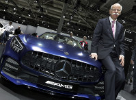 In this May 22, 2019 file photo, Daimler CEO Dieter Zetsche poses prior to the annual shareholder meeting of the car manufacturer Daimler in Berlin, Germany. (AP Photo/Michael Sohn)