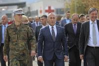 In this Nov. 5, 2018 file photo, Kosovo Prime Minister Ramush Haradinaj, center, visits the German KFOR military base in Prizren. (AP Photo/Visar Kryeziu)
