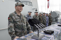 In this April 12, 2018 file photo released by Xinhua News Agency, Chinese President Xi Jinping speaks after reviewing the Chinese People's Liberation Army (PLA) Navy fleet in the South China Sea. (Li Gang/Xinhua via AP)