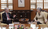 U.S. National Security Advisor John Bolton, left, talks with South Korean Foreign Minister Kang Kyung-wha during a meeting at the Foreign Ministry in Seoul, South Korea, on July 24, 2019. (AP Photo/Ahn Young-joon, Pool)