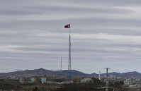 In this April 27, 2018 file photo, a North Korean flag flutters atop a 160-meter tower in North Korea's village Gijungdongseen, as seen from the Taesungdong freedom village inside the demilitarized zone in Paju, South Korea. (AP Photo/Lee Jin-man)
