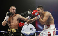 In this Oct. 20, 2018, file photo, Maxim Dadashev, of Russia, left, hits Antonio DeMarco, of Mexico, during a junior welterweight bout in Las Vegas. (AP Photo/John Locher)