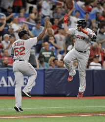 Boston Red Sox third base coach Carlos Febles, left, congratulates pinch hitter Christian Vazquez after his solo home run off Tampa Bay Rays reliever Colin Poche during the seventh inning of a baseball game on July 23, 2019, in St. Petersburg, Fla. (AP Photo/Steve Nesius)