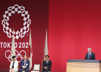 International Olympic Committee (IOC) President Thomas Bach, right, delivers a speech as Japanese Prime Minister Shinzo Abe, President of the Tokyo 2020 Organizing Committee Yoshiro Mori, second from left, and Tokyo Gov. Yuriko Koike, left, listen during a One Year to Go Olympic Ceremony Event in Tokyo, on July 24, 2019. (AP Photo/Koji Sasahara)
