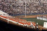 1964 Tokyo Olympics -- The Japanese delegation marches under blue skies during the opening ceremony on Oct. 10. It was first time for Japan to host a summer or winter games. Japan won 16 gold medals, tying the record for the country. A total of 93 nations and regions participated in the global event.