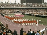 1968 Mexico City Olympics -- The Japanese delegation marches behind the country's national flag. Japan won 11 gold medals in the global event.