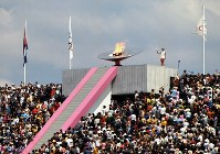 1968 Mexico City Olympics -- The cauldron is ignited by Enriqueta Basilio, the first female anchor in the torch relay in Olympic history.