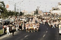 1968 Mexico City Olympics -- The lead group runs through the city in the men's marathon. Abebe Bikila of Ethiopia is seen in the center in the front line of the group.