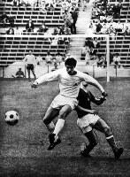 1968 Mexico City Olympics – Japan's Kunishige Kamamoto dribbles the ball past an opposing player.