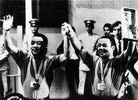 1968 Mexico City Olympics -- Japan's Miyake brothers won the gold and bronze medals in the featherweight division in men's weightlifting. The older Yoshinobu won the gold, while Yoshiyuki took the bronze.