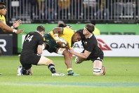 Australia's Isi Naisarani, center, is tackled by New Zealand's Ben Smith and Scott Barrett during their rugby union test match in Perth, Australia, on Saturday, Aug. 10, 2019. (AP Photo/Trevor Collens)