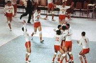 1972 Munich Olympics -- The Japanese men's volleyball team celebrates after defeating East Germany 3-1 in the final. The Japanese, led by head coach Yasutaka Matsudaira, won the gold medal in the event for the first time.