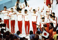 1972 Munich Olympics -- The Japanese men's volleyball team celebrates after winning the gold medal for the first time.
