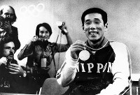 1972 Munich Olympics -- Nobutaka Taguchi, of Japan, won the gold medal in the men's 100-meter breaststroke in a new world record. He also earned the bronze medal in the 200-meter breaststroke.