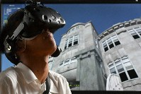 The VR headset used to explore the virtual rendering of Hiroshima before and after the bomb is seen in action on June 8, 2019, at Fukuyama technical high school in Fukuyama, Hiroshima Prefecture. (Mainichi/Naohiro Yamada)