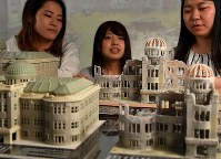 Students at Yasuda Women's University are seen with 3D models of the former Hiroshima Prefectural Industrial Promotional Hall, now the Atomic Bomb Dome, which were used to make 360 degree photographs of its interior, in Asaminami Ward, Hiroshima on July 1, 2019. (Mainichi/Naohiro Yamada)