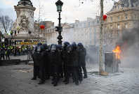 In this Saturday, Feb. 2, 2019 file photo riot police officers take position on the Place de la Republique during a yellow vest protest in Paris. (AP Photo/Francois Mori)