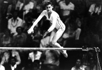 1976 Montreal Olympics -- Nadia Comaneci of Romania, just 14 years old, captured gold medals in the individual all-around, the uneven parallel bars and the balance beam in the women's gymnastics by scoring several perfect 10s. She also gained the bronze in the floor exercise. People across the world were astonished by her amazing performances.