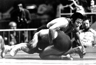 1976 Montreal Olympics -- Japan's Jiichiro Date won the gold medal in the 74-kilogram division in the men's freestyle wrestling.